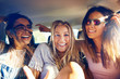 canvas print picture Three beautiful happy girls in a car