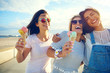 canvas print picture Laughing teenage girls enjoying ice cream cones