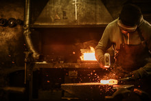 The Blacksmith Forging The Mol...