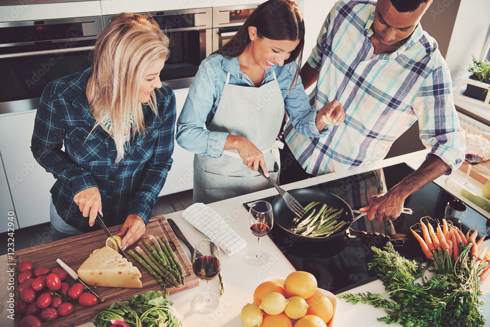 Fototapety, obrazy: High angle view of trio cooking a meal