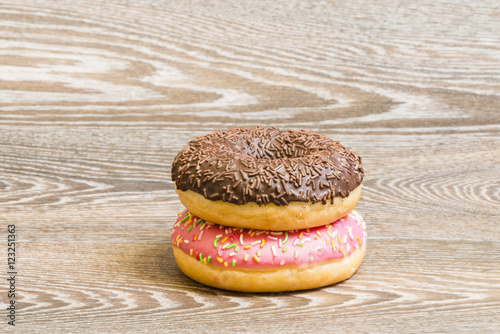 colorful donuts on a wooden background Wallpaper Mural