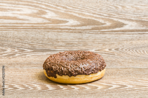 Chocolate donut on a wooden background Canvas Print