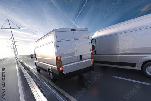 Fotografie, Obraz  3d rendering of generic vans on the road at dawn