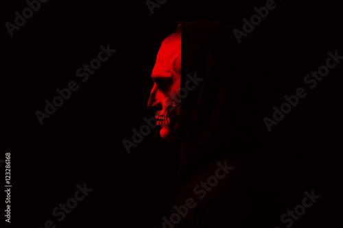 Obraz na płótnie Evil man on black background