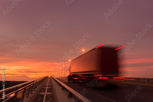 Keuken foto achterwand Vintage cars Beautiful sunset with blured truck on the road