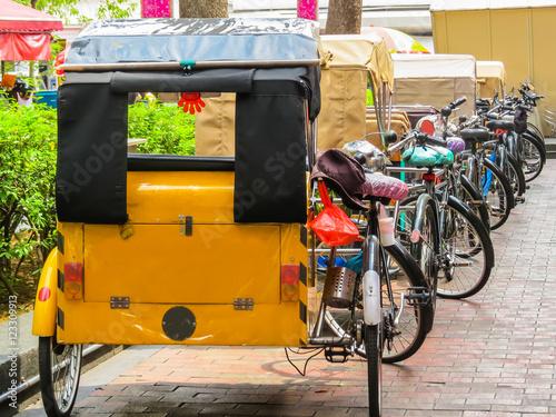 Trishaws expect passengers on the street of Singapore