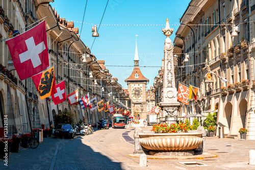 Fotografie, Obraz  Street view on Kramgasse with fountain and clock tower in the old town of Bern city