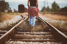 Woman Walking Along Railroad, Banja Luka, Bosnia And Herzegovina
