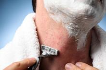 Closeup Man Shaving Razor Burn...