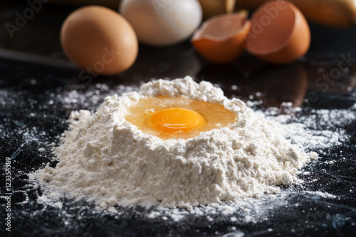 Photo  Baking background with egg and flour
