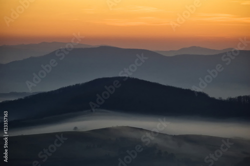 Spoed Foto op Canvas Cappuccino fog on hills at dawn landscape