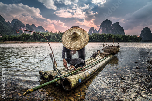 Fotografie, Obraz  Asian fisherman at sunset