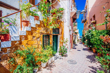 Pictoresque Mediterranean Street With Stairs And Flower Pots, Chania, Island Of Crete, Greece