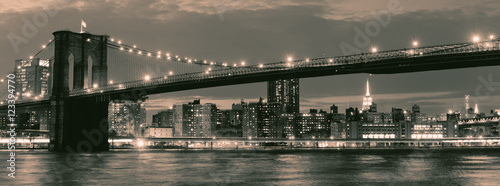 Aluminium Prints Brooklyn Bridge Vintage image of the Brooklyn Bridge illuminated at night