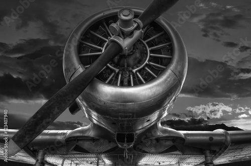 Canvas Print The warplane from the past T-6G HARVARD in black and white photo, cloudy sky b