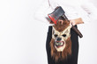 Girl with a wolf mask and a bloody axe in business clothing