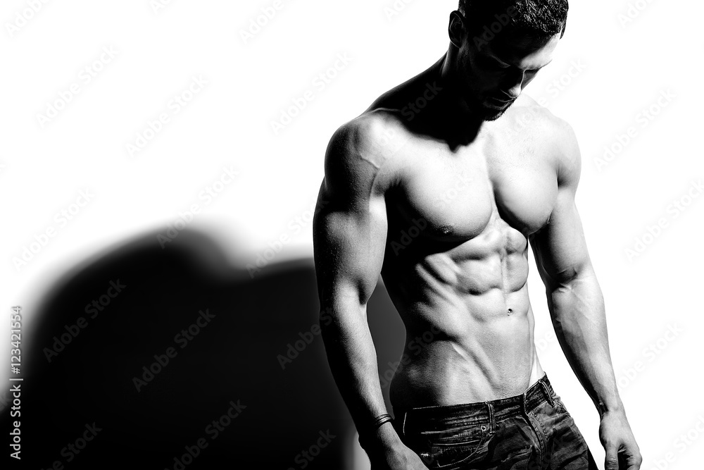 Fototapety, obrazy: Portrait of strong healthy handsome Athletic Man Fitness Model posing near white wall