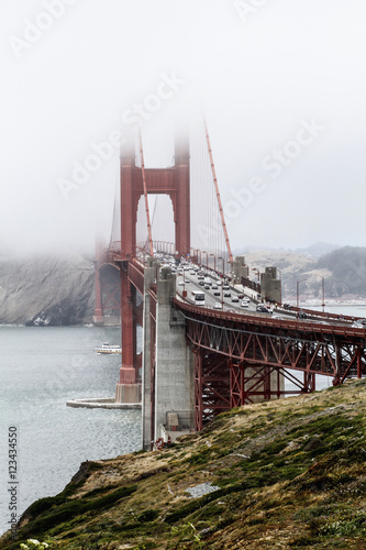View of Golden Gate Bridge over bay of water during foggy weather, San Francisco Poster