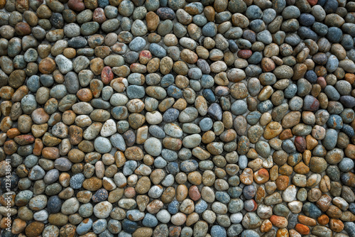 Fotografering  Conglomerate Stone wall background and texture