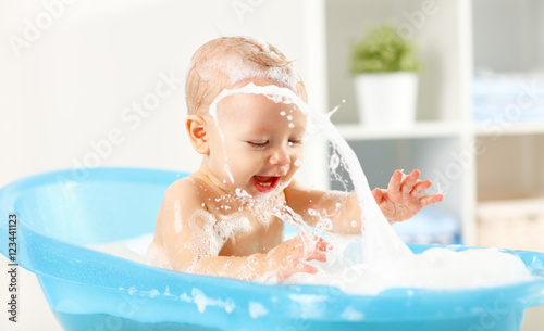 Happy toddler bathing in bathtub Poster Mural XXL
