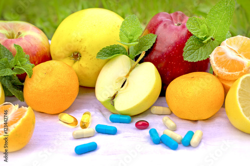 Fotografie, Obraz  Fresh organic fruit and supplements nutrition - recommendations of a healthy die