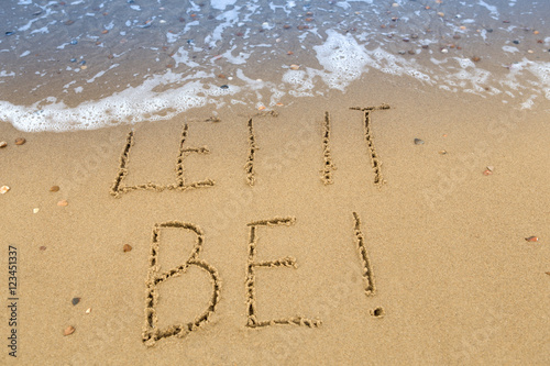 Photo  let it be, written in the sand at the beach