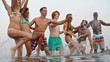 Group of young friends full of happiness dancing in the water and splashing it