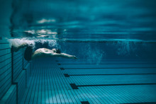 Male Swimmer Turning Over In S...
