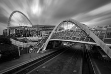 The Wembley Stadium And Wembley Train Station In Black And White