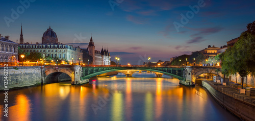Photo sur Toile Paris Paris Panorama. Panoramic image of Paris riverside during twilight blue hour.