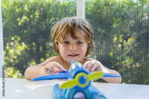Cute child playing with toy at home
