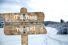 Old Wooden Signpost With The Inscription. It's Time To Ski. In T