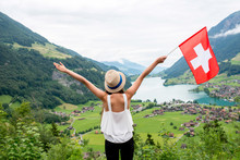 Young Woman With Swiss Flag En...