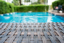 Relaxing Rattan Bed Beside Swimming Pool