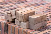New Brick Wall With Some Loose Bricks