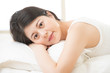 Health woman Smile feel carefree lying on bed in morning