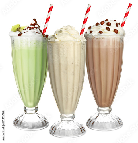 Foto op Aluminium Milkshake Glasses with delicious milk shakes on white background.