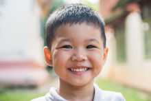 Close Up Portrait Of Asian Boy...
