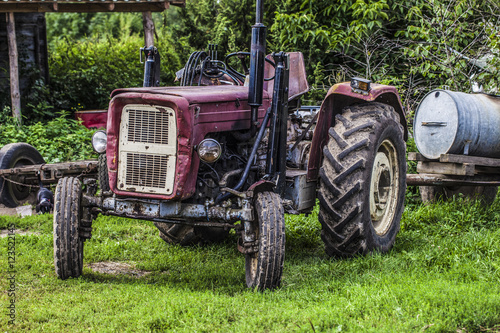 Fototapety, obrazy: old red tractor on the grass