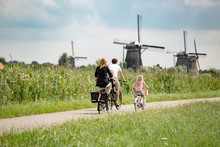 Family On Bikes In Nature