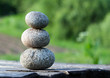 Three stones on a wooden table