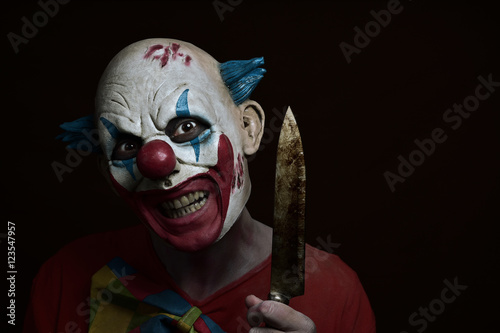 scary evil clown with a knife Canvas Print