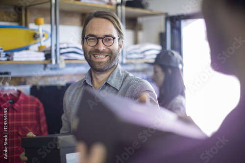 Man buying shoes in fashion shop