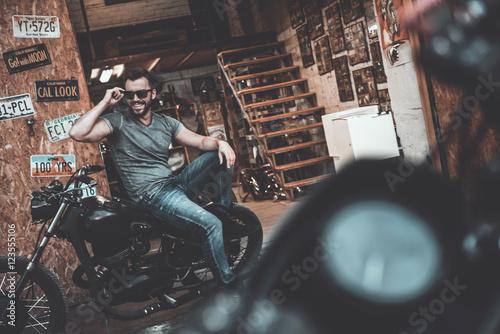Confident biker. Wallpaper Mural