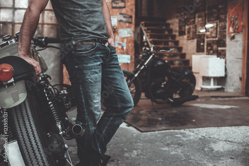 Man near his bike. Canvas Print