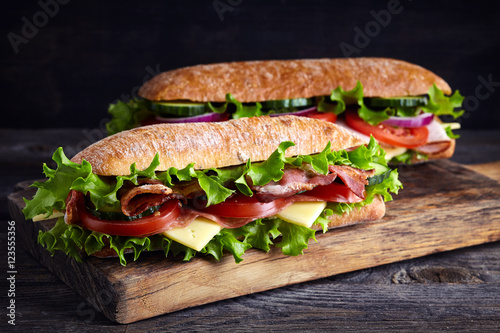 Photo sur Aluminium Snack Two fresh submarine sandwiches