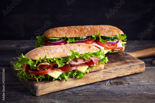 Staande foto Snack Two fresh submarine sandwiches