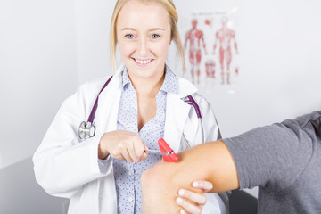 Doctor examining her patient in medical office