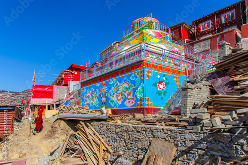 Wall Murals Temple Monastery at Larung gar (Buddhist Academy) in sunshine day and background is blue sky, Sichuan, China