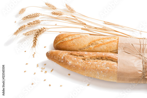 Fotografia, Obraz  Loaves of french baguette bread tied together with paper and str